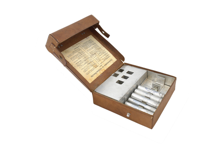 anaesthetic: Germany in the Second World War. Standard military first aid kit and its contents including aluminium pipes for pills and anaesthetic. Stock Photo