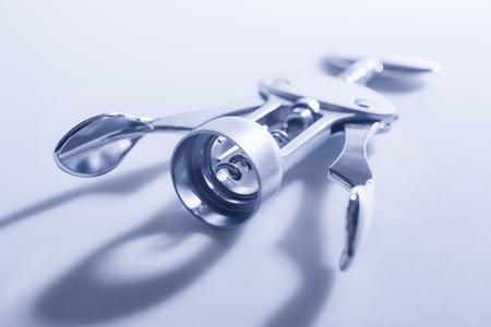 bottle opener: Corkscrew on background. Stock Photo
