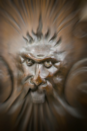 tooled: Carved figures on wood, element of decor. Stock Photo