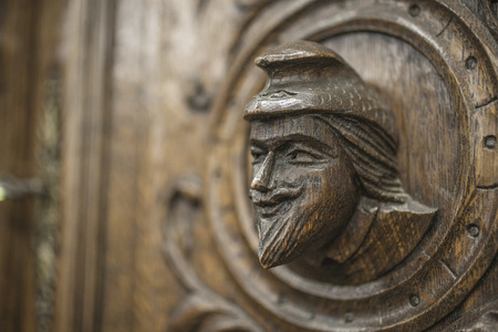 Carved figures on wood, element of decor. Stock Photo