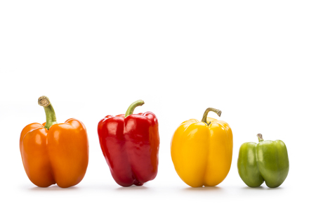 natue: Yellow, red, orange and green paprika isolated on withe  background. Stock Photo
