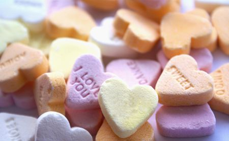 Background of multi color candy hearts with text                   photo