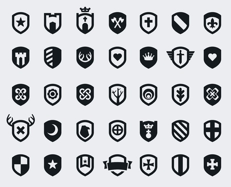Set of 35 shield icons with various medieval and modern symbols 矢量图像
