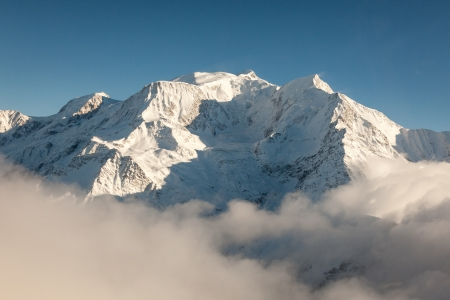 Aerial view of snow covered Mont Blanc in winter from the French side of the alps on a sunny day