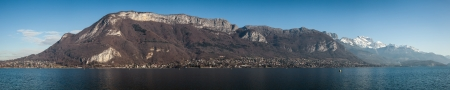 Beautiful panoramic picture of lake Annecy in the French Alps taken on a clear blue sunny winter day  photo
