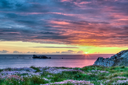 hdr: Multicolored sunset view of a rocky coastline in the Brittany region of France. This is a HDR image.