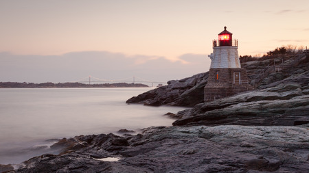 safe water: Castle Hill Lighthouse at sunrise in Newport, Rhode Island, USA