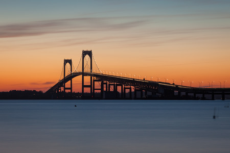 ri: Colorful sunset view of the Pell Claiborne bridge in Newport, Rhode Island, USA  Stock Photo