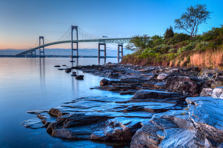 This is a long exposure HDR of the illuminated Newport bridge from Taylor