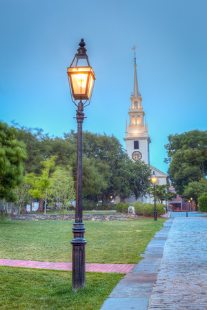 hdr: Historic Trinity Church at night in Newport, Rhode Island, USA  This is an HDR image showing a park lamp in front of a white church and a park  Stock Photo