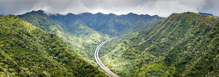 Mountain landscape panorama and scenic view of H3 highway from the Aeia Loop Trail on Oahu, Hawaii.