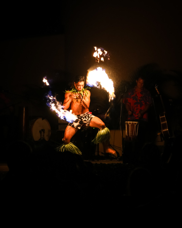 Fire dancer performing at a Luau at the Hale Koa hotel in downtown Honolulu, Oahu, Hawaii.