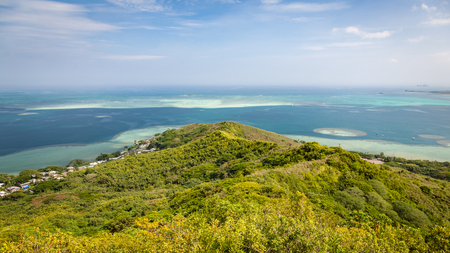 Panoramic landscape view of the Kaneohe sandbar from a pillbox hike near the tropical, blue paradise waters of Oahu, Hawaii, USA.