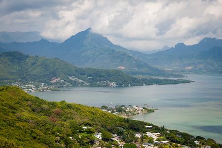 Coastal seascape with mountains and bay near Kualoa Ranch on windward side of Oahu, Hawaii, USA.