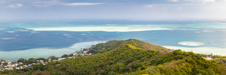Panoramic landscape view of the Kaneohe sandbar from a pillbox hike near the tropical, blue paradise waters of Hawaii. Stock Photo
