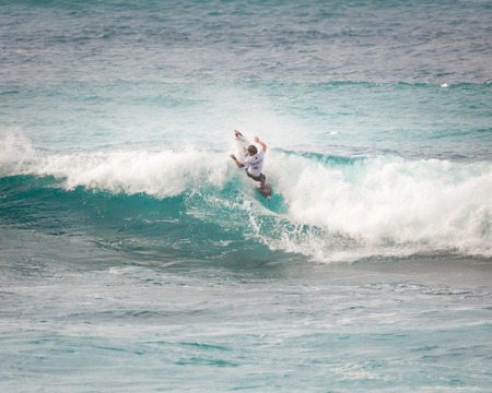 SUNSET BEACH, HAWAII, USA - DECEMBER 2: Surfer, Conner Coffin, competing at the 2017 Vans World Cup of Surfing competition at Sunset Beach on Oahus scenic North Shore. This is the second of three surfing competitions and Conner Coffin took first place.