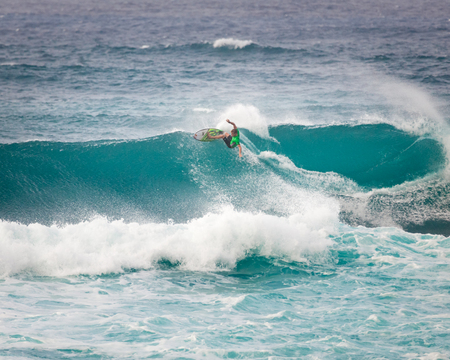 SUNSET BEACH, HAWAII, USA - DECEMBER 2: Surfer, Kolohe Andino, competing at the 2017 Vans World Cup of Surfing competition at Sunset Beach on Oahus scenic North Shore. This is the second of three surfing competitions and Conner Coffin took first place.