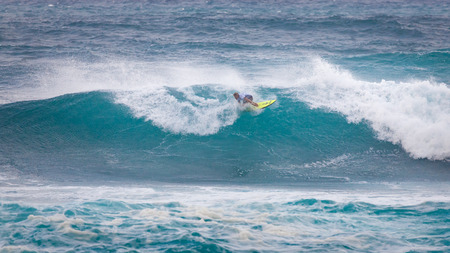 SUNSET BEACH, HAWAII, USA - DECEMBER 2: Surfer competing at the 2017 Vans World Cup of Surfing competition at Sunset Beach on Oahus scenic North Shore. This is the second of three surfing competitions and Conner Coffin took first place. Editorial