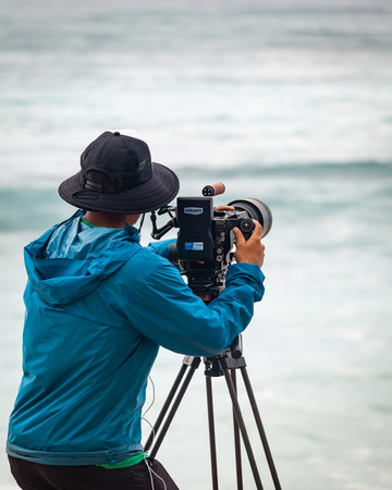 SUNSET BEACH, HAWAII, USA - DECEMBER 2: Videographer at the 2017 Vans World Cup of Surfing competition at Sunset Beach on Oahus scenic North Shore. This is the second of three surfing competitions and Conner Coffin took first place.