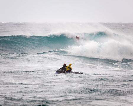 SUNSET BEACH, HAWAII, USA - DECEMBER 2: Surf patrol in front of massive wave break at the 2017 Vans World Cup of Surfing competition at Sunset Beach on Oahus scenic North Shore. This is the second of three surfing competitions and Conner Coffin took firs