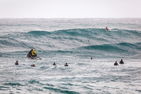 SUNSET BEACH, HAWAII, USA - DECEMBER 2: Surfers waiting for waves at the 2017 Vans World Cup of Surfing competition at Sunset Beach on Oahus scenic North Shore. This is the second of three surfing competitions and Conner Coffin took first place.