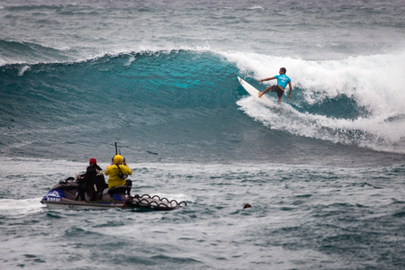 SUNSET BEACH, HAWAII, USA - DECEMBER 2: Surf patrol filming surfer competing at the 2017 Vans World Cup of Surfing competition at Sunset Beach on Oahus scenic North Shore. This is the second of three surfing competitions and Conner Coffin took first plac Editorial