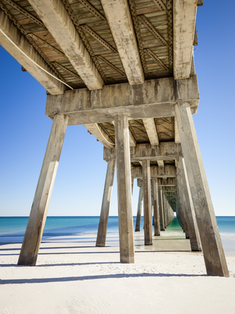 Pensacola Beach Pier is located on Casino Beach. The pier is 1,471 feet long, and boasts some of the best fishing in the area. The pier has concrete pillars for added support and stability. Stock Photo