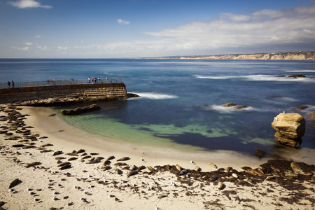 Beautiful long exposure landscape and seascape of Children's Cove in La Jolla, California. Sea Lions are seen on the beach during breeding and mating season. 스톡 콘텐츠 - 101513786