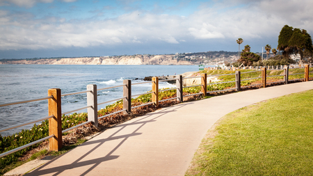 Long concrete walking path along the coastal cliffs of La Jolla, California on a bright sunny day. 스톡 콘텐츠 - 101484691