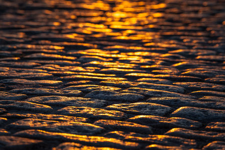 Detailed and rough, old cobblestone street or walkway background at sunset. 스톡 콘텐츠