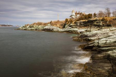 NEWPORT, RHODE ISLAND  USA, FEBRUARY 24, 2018 - Rocky, coastal seascape of Castle Hill Inn on the coastline of Newport, Rhode Island, USA.