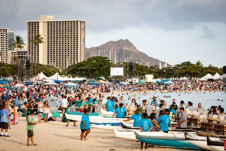 HONOLULU, HAWAII/USA – MAY 28, 2018: Lantern floating ceremony crowd at Ala Moana Beach Park on Magic Island in downtown Honolulu, Oahu, Hawaii, USA with Diamond Head in background. This is an annual Memorial Day event that gathers 50,000 people from ar Editorial