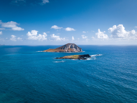 Aerial drone view of blue seascape and State Seabird Sanctuary and Rabbit Island off Makapuu Point on Oahu, Hawaii, USA. 스톡 콘텐츠 - 106363595