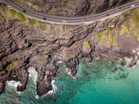 Aerial drone view of rocky Makapuu Point coastal landscape and highway with cars on Oahu, Hawaii, USA. 스톡 콘텐츠 - 106363596