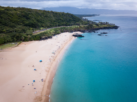 Aerial landscape of Waimea Bay Beach Park on Oahu, Hawaii north shore, shown near sunset. 스톡 콘텐츠