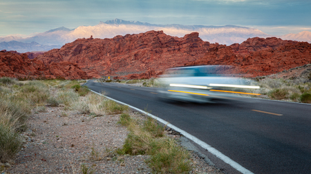 Blurred car headlights driving along the road in the Valley of Fire State Park. 스톡 콘텐츠 - 122470309
