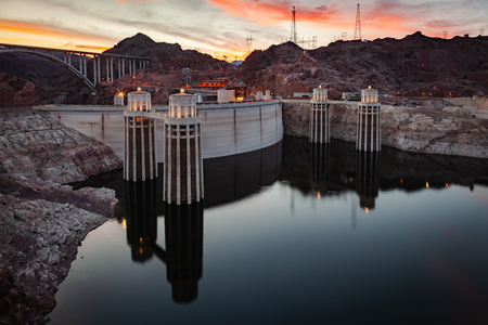 Hoover Dam at night at Lake Mead on the border of Nevada and Arizona in southwestern United States is considered the eigth wonder of the world.