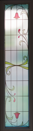 An usual stain glass window with red green and yellow decoration. Would appear to be ancient design the origin of which is unnown.