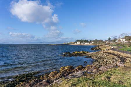 The town of largs Scotland in the distance from the South shore on a cold but bright day. Stock Photo