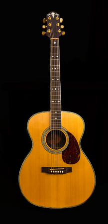 Ancient accoustic guitar ouned by the contributor make not known been in the family for many years. Stock Photo