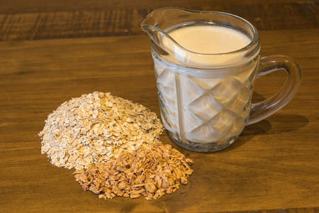 Porridge Granola & Milk are all the ingredients required for a healthy nutricional breakfast
