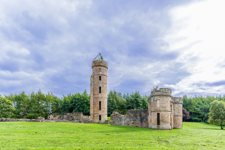 Eglinton castle Ruins taken on a cloudy day before it rained. Surrounded by trees it is situated with the Eglinton park Irvine Scotland Stock Photo