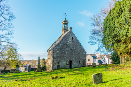 Lochwinnoch,Scotland,UK-November 18,2017: The early 18th-century St John's Church, also known as 'Auld Simon' (whose front gable still stands at the eastern end of the High Street), was probably built on the site of a pre-Reformation church dating to the