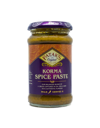 Largs, Scotland, UK - January 14, 2018: A popular branded jar of Patak's Korma Curry paste on white background associated with quick preparation of meals at home. Taken against a white background