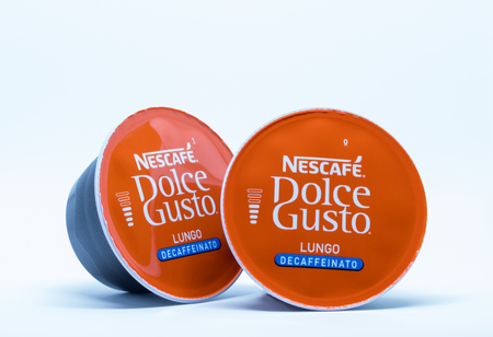 Largs, Scotland, UK - February 02, 2018: Two small decaffe refills for the Nescafe Dolce Gusto Coffee Machines on a white backgropund. Fast becomong popular in home prepared caffe drinks. Taken against a white background.