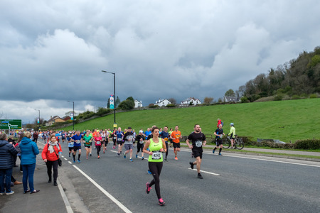 Stirling, Scotland, UK - April 29, 2018: Lead runners of the first Srirling marathon and half marathon as they left their starting points below the walls of Stirling Castle. The first of what is to become an annual event in the Sottish city.