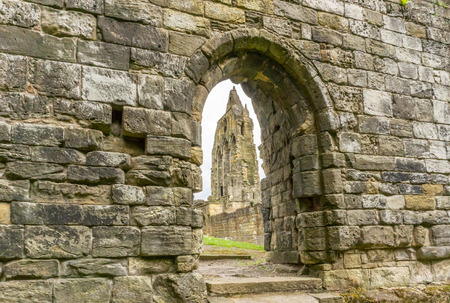 Looking through the  old stone entrance to The Old Transept Ancient Ruins Kilwinning Abbey Scotland. Stock Photo