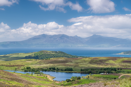 The magnificent Isle of Arran looking through a June heat haze that is sitting on top of the water