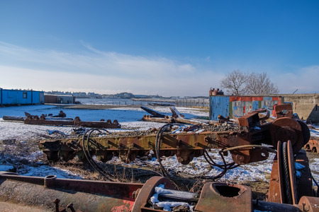 Irvine Harbour in winter with the remains of the old harbour equipment and winding gear and looking out to the harbour and beyond
