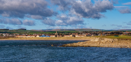 From Ardeen shoreline over to the town of Stevenston on the North Ayrshire coast of Scotland on a october breezy day.
